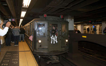 standard steel: BRONX, NEW YORK, USA - APRIL 10:  Low Voltage train stops at 42nd street headed to Yankee Stadium for opening game.  Taken April 10, 2017 in New York. Editorial