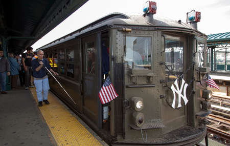 standard steel: BRONX, NEW YORK, USA - APRIL 10:  A vintage Low Voltage train from the early 1900s  stops at Yankee Stadium for opening day game.  Taken April 10, 2017 in New York.