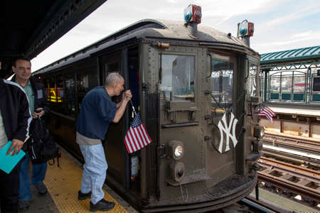 standard steel: BRONX, NEW YORK, USA - APRIL 10:  Blind man asks directions from conductor of Low Voltage vintage train at Yankee Stadium used for opening day game.  Taken April 10, 2017 in New York.