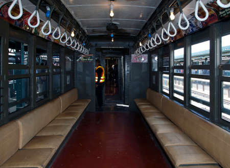 standard steel: BRONX, NEW YORK, USA - APRIL 10: Interior of a  vintage Low Voltage train from the early 1900s  stops at Yankee Stadium for opening day game.  Taken April 10, 2017 in New York.