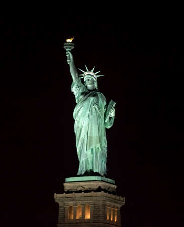 Statue of Liberty at night in New York Harbor USA. Stock fotó