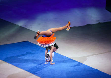 BROOKLYN, NEW YORK - FEBRUARY 25: Lady and dog perform during Ringling Bros Barnum Baley Circus.  Taken February 25, 2017 in New York.