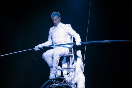 BROOKLYN, NEW YORK - FEBRUARY 25: Lazslo Simet and partner dressed as astronaut  balancing on Simet wheel at Barclays during Ringling Bros Barnun Baley Circus.  Taken February 25, 2017 in New York.