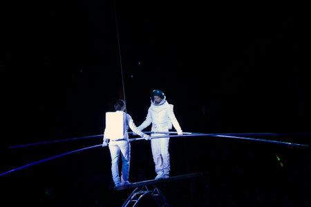 BROOKLYN, NEW YORK - FEBRUARY 25: Laszlo Simet and family dressed as astronauts  balance on Simet wheel at Barclays during Ringling Bros Barnun Baley Circus.  Taken February 25, 2017 in New York.