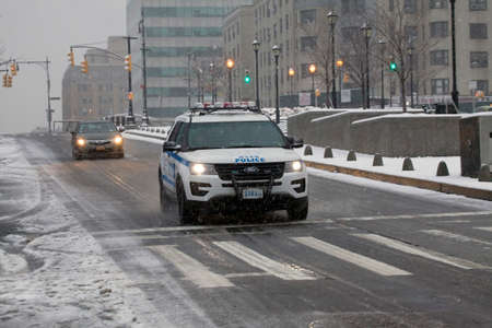 BRONX, NEW YORK - March 21: Police car does patrol during snow storm.  Taken March 21, 2018 in New York.