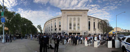 BRONX, NEW YORK - MAY 11: Wide angle view of Yankee Stadium with police and fans.  Taken May 11, 2018 in New York.