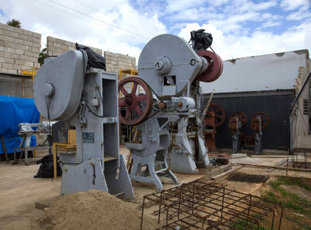 CERRO GORDO, BAYAMONPUERTO RICO - February 26, 2019: Old and no longer used metal work machines once used to press and stamp metal and provide parts for autos and military.