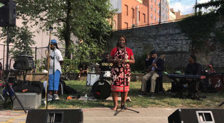 BRONX, NEW YORK/USA - July 14, 2018: Council member Vanessa L Gibson speaks at the open mic in the park hosted by the Morrisania band project. Held at Rev. Lena Irons Unity Park.