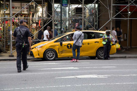 NEW YORK, NEW YORK/USA - June 25, 2019: Service professionals on the scene after a taxi is side swiped by another car. Editorial