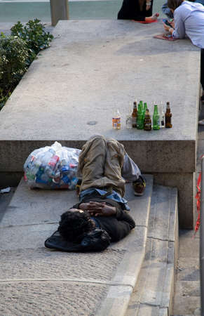 NEW YORK, NEW YORK/USA - May 21, 2019: Black male who recovers bottles and cans sleeps in front of main Post Office building.