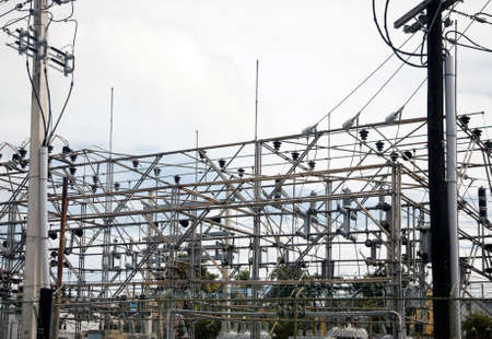 BAYAMON, PUERTO RICO/USA - February 15, 2019: View of power grid with poles and wires that provide energy to community. Banco de Imagens