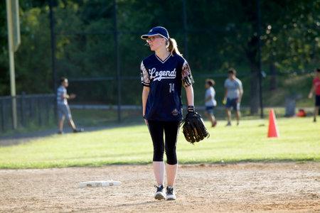 BRONX, NEW YORKUSA - August 10, 2019: Female pitcher during game in public park near Yankee Stadium.