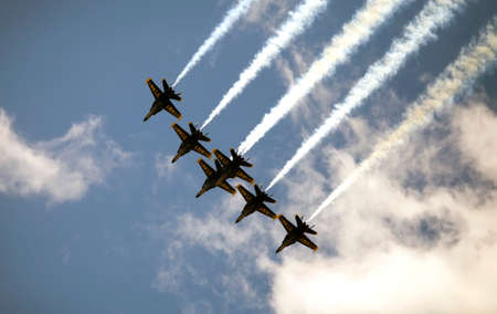 NEW YORK, NEW YORK/USA - April 28, 2020: Blue Angels aircraft fly over city to honor healthcare and essential workers during Coronavirus pandemic.