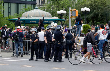 NEW YORK, NEW YORK/USA - June 2, 2020: Cops wear helmets while working Union Square NYC during George Floyd protest.