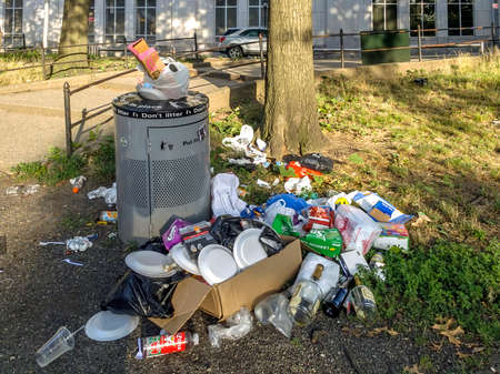 BRONX, NEW YORK/USA - August 2, 2020: Trash builds up at a public park near Yankee Stadium due to budget cuts to sanitation by Mayor Bill Deblasio.
