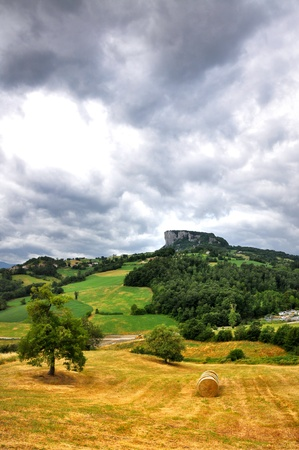 a view of the famous Pietra di Bismantova with contrasts and a dramatic sky