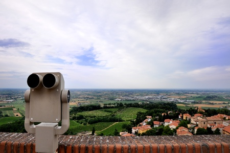 a view from a panoramic terrace of a typical village of Romagna, Italy with a binocular on the left Stock Photo - 10869799