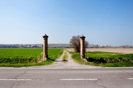 Italian Po Valley - gate to fields Stock Photo - 12928531