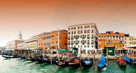 Venezia, Italy - Gondolas on Grand Canal and San Marco bell tower on the left Editorial