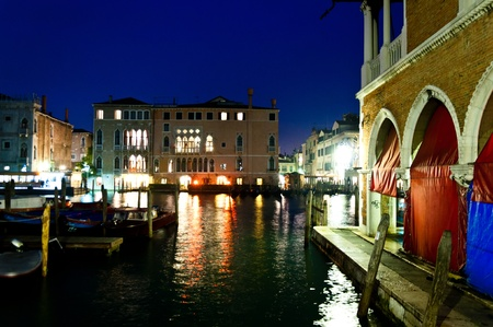 Venice, Italy - night view of Canal Grande, boats and houses