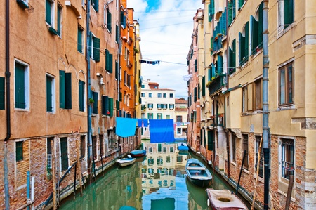 Venice, Italy - canal, boats and houses photo
