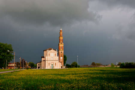 church and dramatic landscape in the village of Sesso, Italy Stock Photo - 13854655