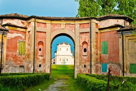 church framed in old ruined building in the village of Sesso, Italy Stock Photo - 13854658