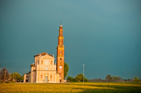 church and dramatic landscape in the village of Sesso, Italy