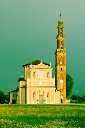 church and dramatic landscape in the village of Sesso, Italy Stock Photo - 13854654