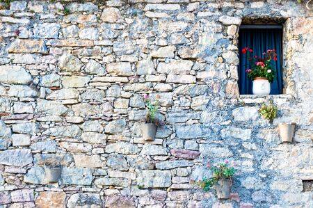 typical mediterranean facade with window and flowers photo