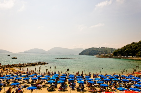 JUNE 2012  Tourists rest on Venere Azzurra Beach awarded with the prestigious Blue Flag and enjoy the sea in a hot day on June 03, 2012 in Lerici Editorial