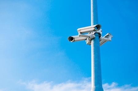 security cctv cameras on blue sky
