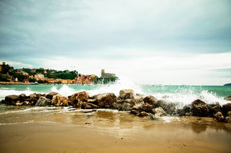 Lerici in Liguria with waves crashing on rocks Stock Photo