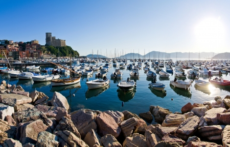 Lerici in Liguria with houses, Castle, boats and the blue mediterranean sea
