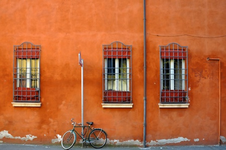 bike parked in front of an old renoved building in Ferrara