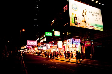 sha: Hong Kong S.A.R., China - July 30, 2012: Neon signs on Nathan Road in Kowloon, Hong Kong on July 30, 2012. Nathan Road is the main thoroughfare in Kowloon, and goes from Tsim Sha Tsui to Mong Kok. It is lined with shops, restaurants and tourists.