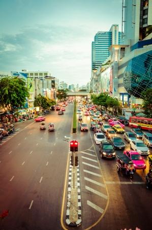 thanon: BANGKOK, THAILAND - AUGUST 04, 2011: pedestrians and traffic on Thanon Ratchadamri road in Bangkok next to MBK shopping centre Editorial
