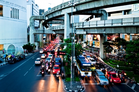 Bangkok, Thailand - August 04, 2011: traffic on Thanon Ratchadamri road under The Sky-Train in Bangkok