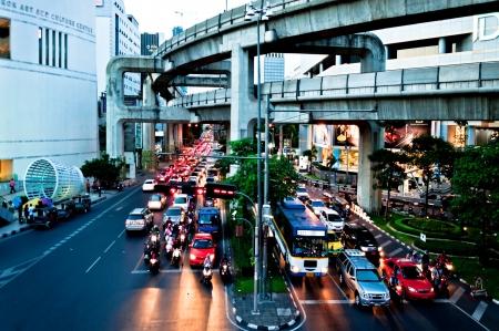 thanon: Bangkok, Thailand - August 04, 2011: traffic on Thanon Ratchadamri road under The Sky-Train in Bangkok