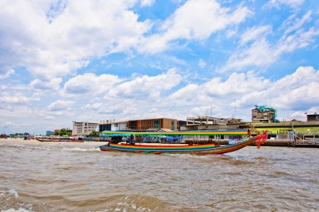 frequent: BANGKOK, THAILAND - AUGUST 08: typical long tail boat down Chao Praya river in Bangkok on 08 august 2012 Editorial