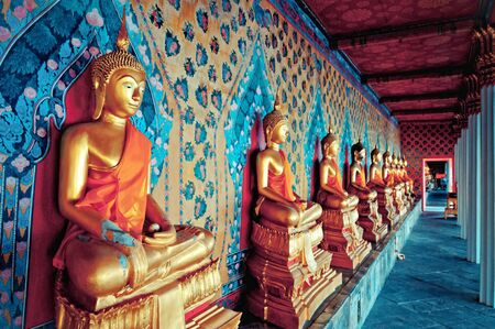 thai ethnicity: golden statues of Buddha in Wat Arun temple, Bangkok Stock Photo