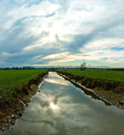 creek in Italian Po valley running among cultivated fields in winter Stock Photo - 17382052
