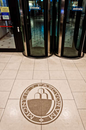 scandal: PIOMBINO, ITALY - MARCH 04: entrance of Monte dei Paschi di Siena bank branch with logo on the floor on March 04, 2013 in Piombino. MPS is one of the main banks in Italy and is involved in big scandal Editorial