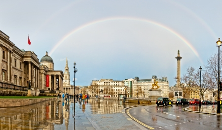 LONDON - APRIL 12  rainbow over Trafalgar Square on April 12, 2013 in London  The capital of UK is one of the most popular tourist attraction on Earth, with more than fifteen million visitors a year