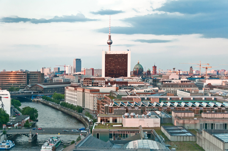 BERLIN, GERMANY - JUNE 08  aerial image of Berlin skyline with Television Tower at sunset on June 08, 2013 in Berlin, Germany  With a population of 3 3 million people, Berlin is Germany s largest city  Editorial