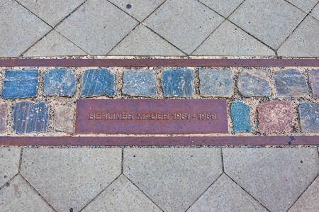 mark of remains of berlin wall in Berlin, Gemany  Place of the Berlin wall until 1989, now part of a street  Editorial