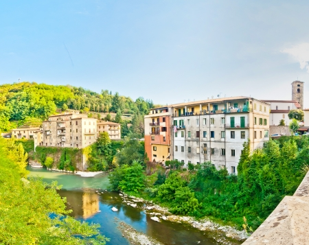 quoted: CASTELNUOVO GARFAGNANA, ITALY - AUGUST 16  tourists visit the main square on August 16, 2013 in Castelnovo Garfagnana, Italy The village is quoted for the first time in a 8th century official document
