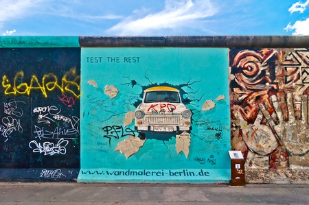 east berlin: Trabant painting on Berlin Wall
