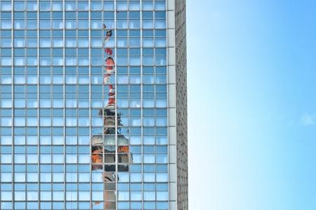 u bahn: Television Tower reflected on skyscraper in Berlin
