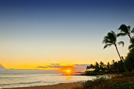 sunset at Poipu Beach Park, on the southern coast of Kaua  699;i island in Hawaii
